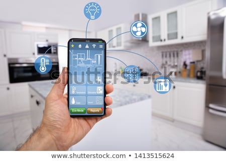 Hand Holding Mobile With Smart Home Control Icon Feature Stock photo © AndreyPopov