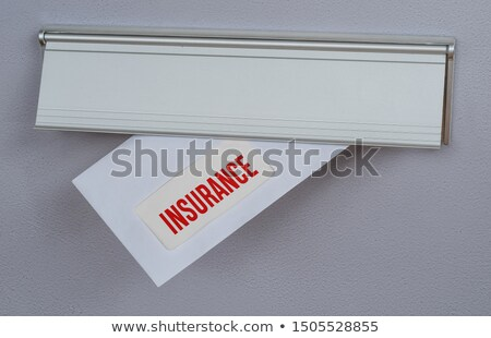 A letter in a mail slot - Health Insurance Stock photo © Zerbor