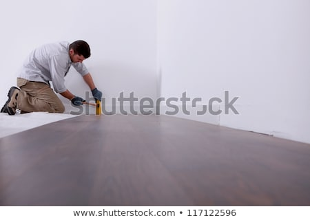Artisan laying parquet Stock photo © photography33