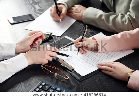 Woman with glasses and folders in hand Stock photo © photography33