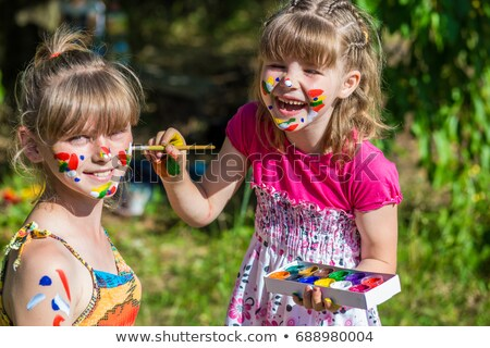 Stock photo: girls playing painting each other