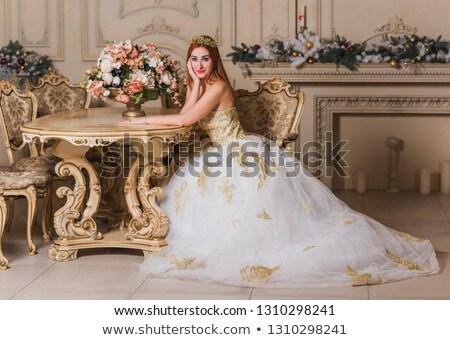 Portrait of a girl in golden dress Stock photo © Nejron
