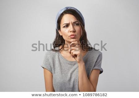 Pretty brunette with finger on chin looking away Stock photo © wavebreak_media