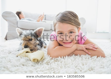 Girl lying on rug,  looking to camera Stock photo © IS2