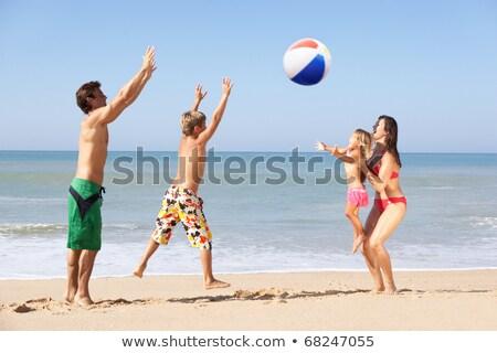 Ragazzo spiaggia giocare palla cielo bambino Foto d'archivio © IS2