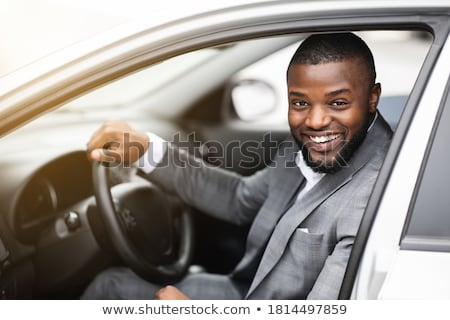 Man steering a wheel in his office. Stock photo © photography33