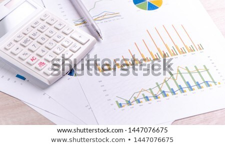 office table with calculator pen and accounting document stock photo © tannjuska