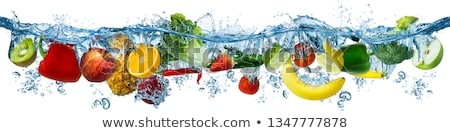 Orange citrus slice falling into water Stock photo © juniart