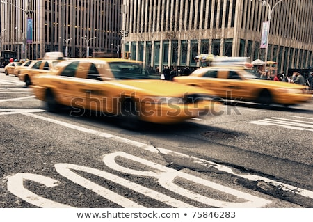 Abstract blur of urban street scene with a yellow taxi cab in Ne Stock photo © boggy