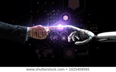 Businessman Touching Robot Finger Stock photo © AndreyPopov