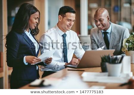 zakenlieden · business · vrouw · glimlach · gelukkig - stockfoto © Minervastock