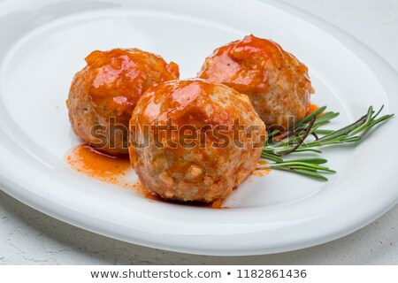 bowl of meatballs with tomato sauce stock photo © alex9500
