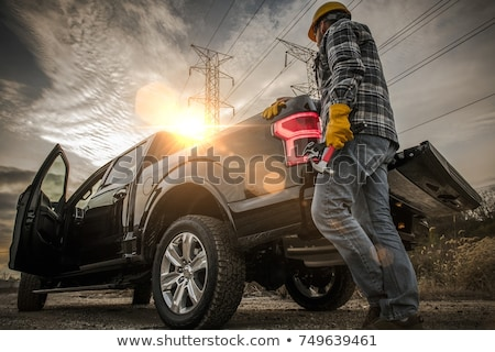 Beszállító teherautó ül mosolyog férfi építkezés Stock fotó © Lopolo