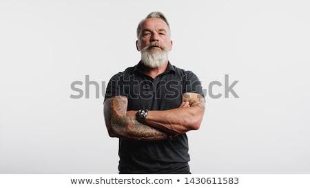 Sério homem tatuagem braço branco camisas Foto stock © ruslanshramko