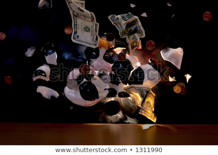 Piggy bank little girl iluminação bomba dinheiro menina Foto stock © erierika