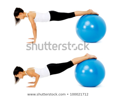 Portrait of fit and healthy woman with toning ball at fitness cl Stock photo © HASLOO