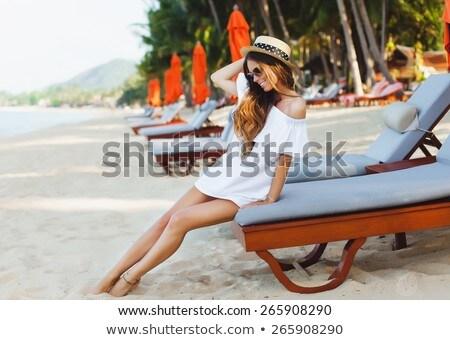 Stock photo: Attractive Teenage Girl Wearing Dress On Beach Holiday