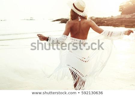 Gorgeous beautiful woman in swimwear Stock photo © deandrobot