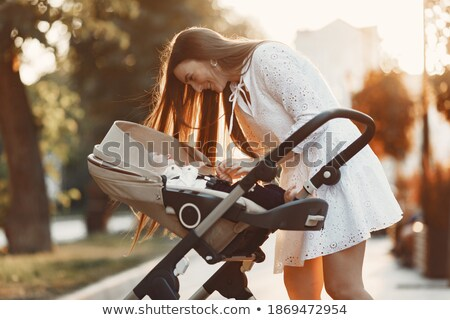 Woman Walking with Perambulator and Kid in Park Stock photo © robuart
