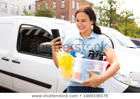 Woman Using Cellphone Holding Cleansing Products Stock photo © AndreyPopov