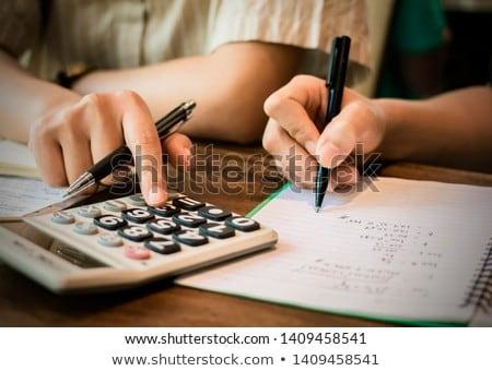 Examining notes in accounting book Stock photo © pressmaster
