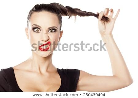 Image of amusing caucasian woman grimacing and making fun on camera Stock photo © deandrobot