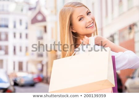 blonde carrying shopping bags on shoulder stock photo © photography33