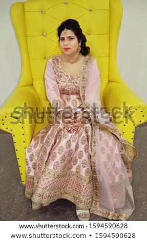 woman in frock on sofa Stock photo © imarin