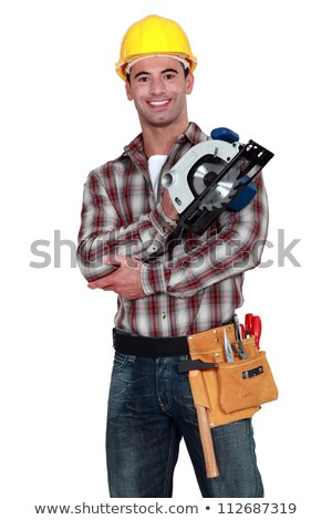 Tradesman holding a power tool Stock photo © photography33