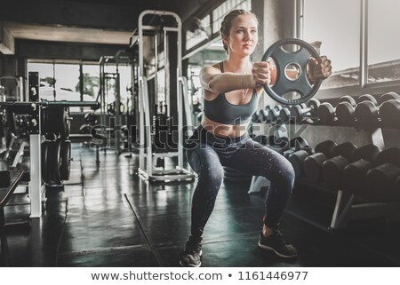 young woman doing exercises with dumbbells Stock photo © photography33