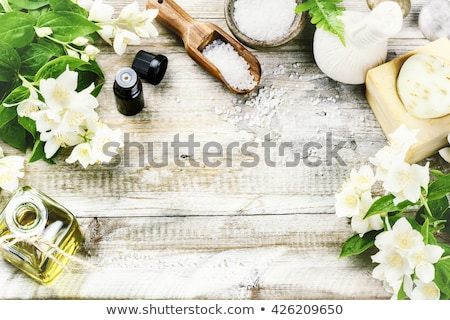 Spa setting with natural soaps and flower Stock photo © caimacanul