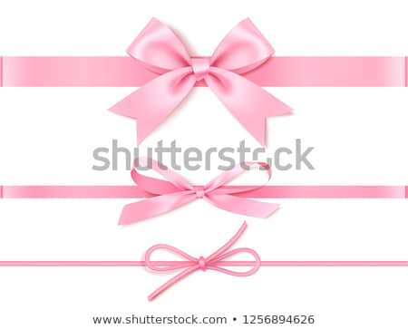 Rózsaszín íj fényes rózsaszín szalag kereszt ajándék Stock fotó © Pruser