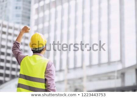 As mãos levantadas vermelho camisas amarelo capacete de segurança Foto stock © stevanovicigor