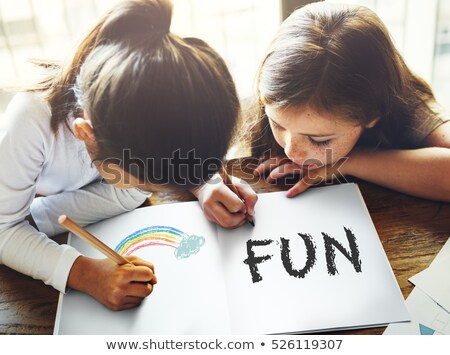 cheerful young girl writing the word happiness Stock photo © nenetus