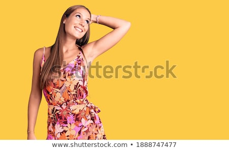 brunette smiling, posing and touchig hands Stock photo © feedough