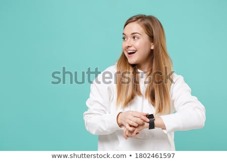 Hand with smartwatch and blue background Stock photo © ra2studio
