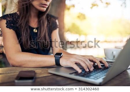 zakenvrouw · met · behulp · van · laptop · buiten · kantoor · stad · werken - stockfoto © deandrobot
