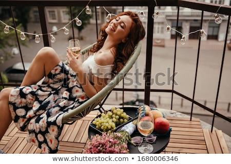 Vonzó fiatal fehér szoknya fiatal nő fal Stock fotó © boggy