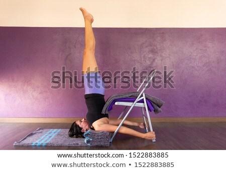 Woman in shoulder stand Yoga posture (Sarvangasana) Stock photo © lichtmeister
