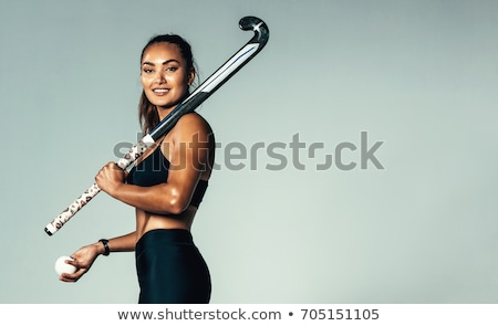 Portrait of hockey ball player with hockey stick Stock photo © Lopolo