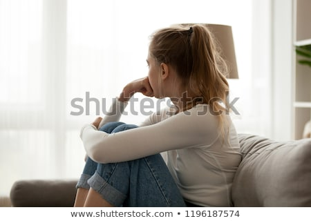 Depressed/anxious young woman suffering from solitude Stock photo © lightpoet