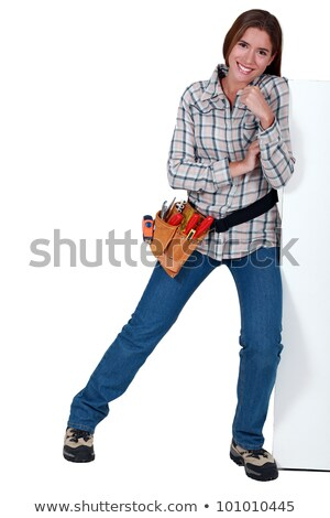 A female construction worker pushing against a wall. stock photo © photography33
