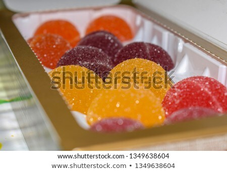 Round jelly sprinkled with sugar in a plastic box. Stock photo © RuslanOmega