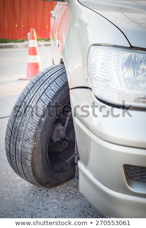 Car crash accident, impact to front wheel axle and bumper is bro Stock photo © FrameAngel