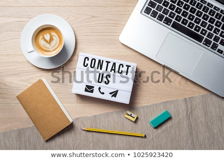 Contact Us text on notepad Stock photo © fuzzbones0