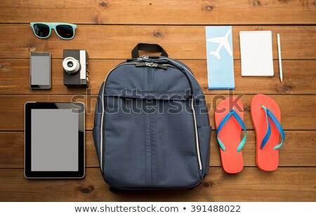 close up of camera and traveler personal stuff stock photo © dolgachov