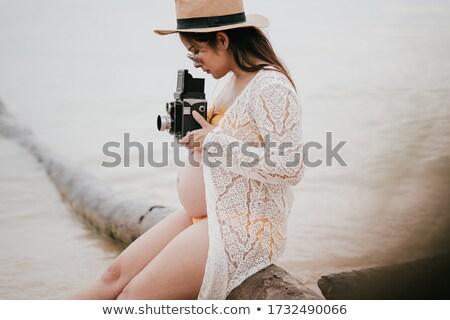 Narancs bikini gyönyörű fiatal nő fémes Stock fotó © disorderly