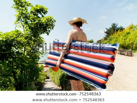 A girl with a Lilo going to the beach Stock photo © IS2