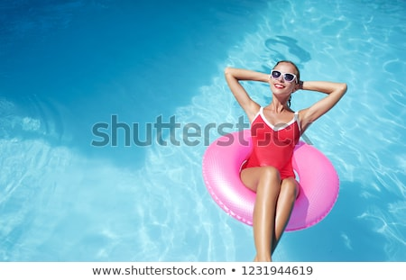 young woman with inflatable ring by swimming pool portrait stock photo © is2