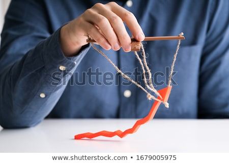 Businessperson Manipulating Red Arrow Stock photo © AndreyPopov